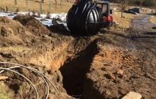 zasazení vodní nádrže do země bagrem kubota